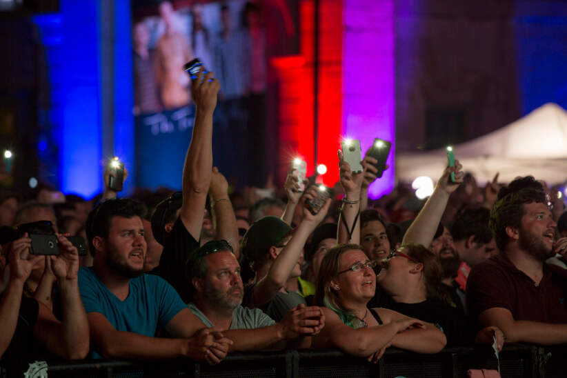 Tragically Hip fans watch the final concert in downtown Kingston. (Photograph by Nick Iwanyshyn)