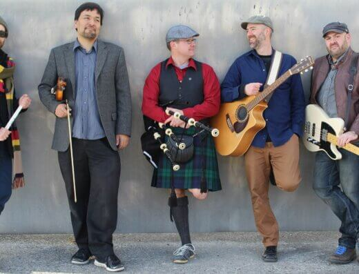 Kingston's Celtic Kitchen Party band members pose for a press photo