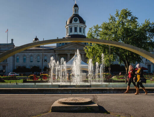 Live music performances are often opposite this water fountain in Kingston's beautiful Confederation Park, set against Kingston's city hall building.